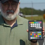 Cemal holding ColorChecker Passport