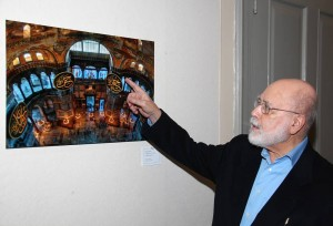 Cemal Ekin explaining details of one of his prints